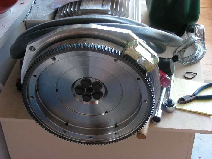 Motor with flywheel attached